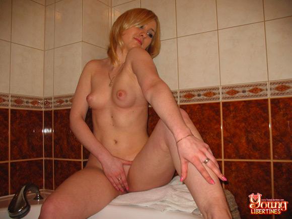naughty-blonde-slut-fingers-her-slit-in-a-bathroom