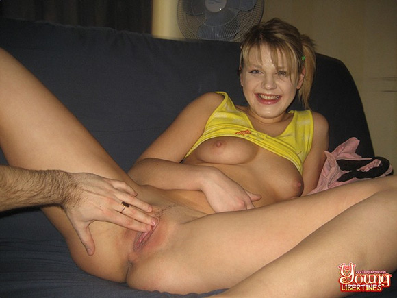 cheerful-girl-gets-nailed-doggy-style-while-her-asshole-is-fingered